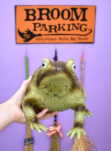 How fun is this DIY broom parking sign complete with parked brooms? Get the free cut files to make your own witch parking + tutorial!