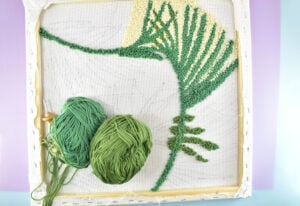 Check out this totally free palm frond punch needle. It is modern embroidery at its finest!
