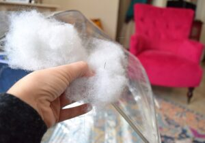 Apply a handful of polyester filling to the exterior of a bubble umbrella.