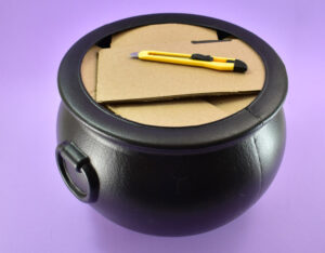 To keep the cauldron lightweight and to use less foam, cut up and fill the inside with cut cardboard.