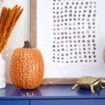 This drilled pumpkin light is super easy to make and looks great on display all fall long! See how to make your own with this full tutorial!