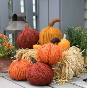 We love these 20+ knit, crochet, loom knit, and otherwise DIY yarn pumpkins you are going to want to craft up this fall!