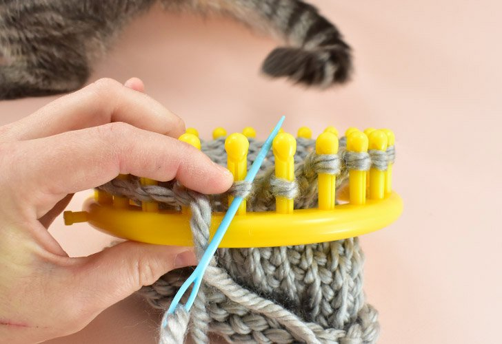 Quick Tip - If the loop tries to slip off of the loom, hold it in place with one hand while pulling your needle through with the other.