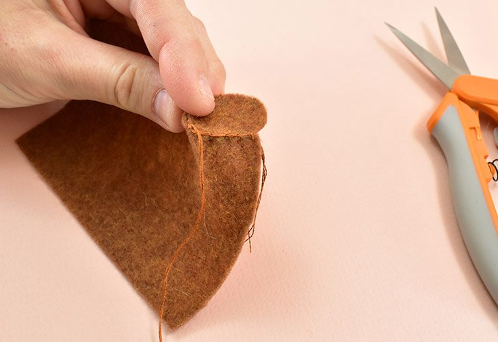 Using the blanket stitch, sew together the round and long side of the rectangle pieces to form a stem.