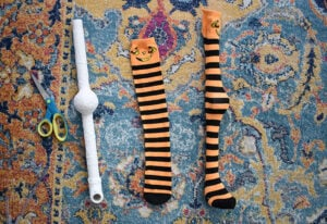 Take a long sock (these are children's knee high socks) and cut it down the back side stopping just before you get to the heel.