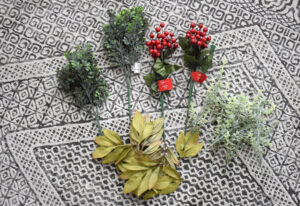 Gather your fake florals and using wire cutters trim into individual stems, if necessary.
