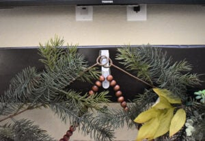 Place clear Command Hooks wherever you would like for your garland to hang. Be sure to place hooks evenly apart and but close enough that the garland makes elegant swags.