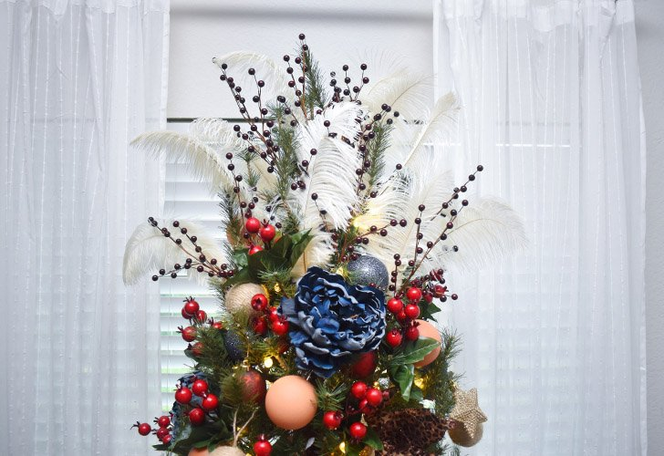 No tree topper? No problem! See how to make a totally customized topper out of feathers, holiday picks and floral stems!