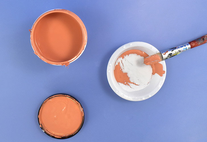 Place approximately 1-2 tablespoons of terra cotta colored paint in a small dish or paint palette bowl. Add 1 teaspoon of baking soda.