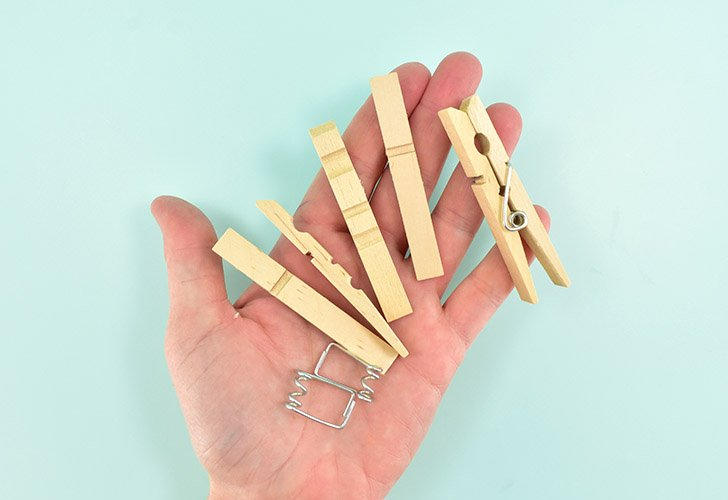 Take apart several clothespins and get rid of the springs.