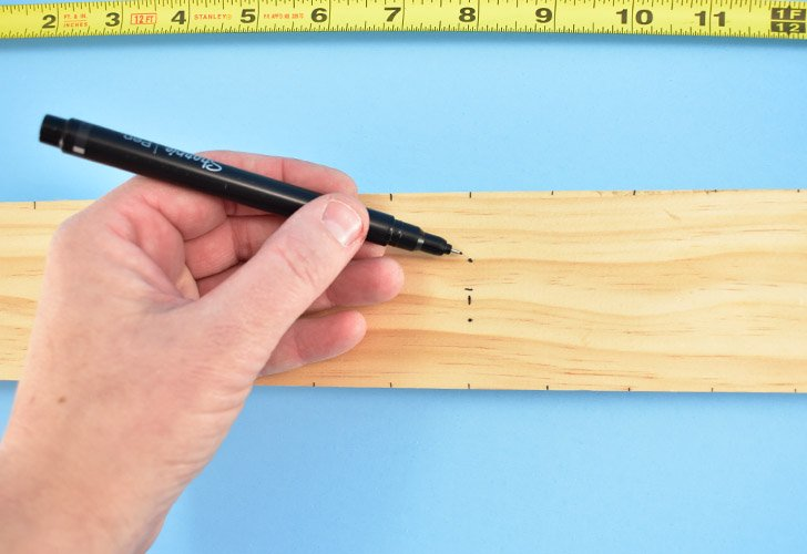 """If creating your ruler by hand, mark the center of the 20"""" piece of wood lightly. To the right of the center mark measure out the next 10"""" marking each inch and half inch. repeat for the other side."""