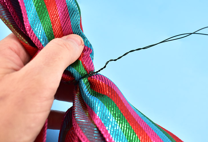 With your fingers twist the 2 wire tails around one another to form a thicker cord.