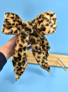I've made SO MANY bows with my DIY bow maker. Check out this leopard fur jobbie. I have no clue what I'll use it for but I still LOVE IT.