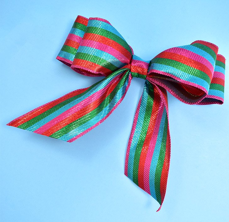 Wrap a small piece of ribbon around the join on the front, hot gluing both ends on the back.