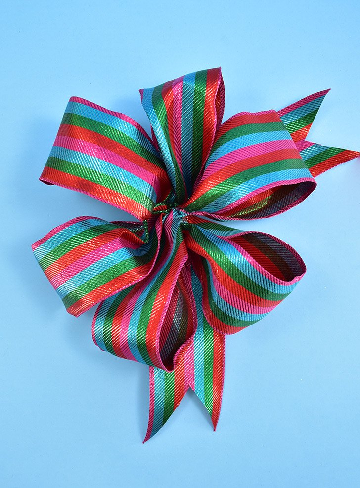 It is the season for bows upon bows! See how easy it is to make perfect bows with a DIY bow maker that costs less than $3!
