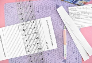 Continue cutting the cards out using the faint gray marks to guide your ruler placement.