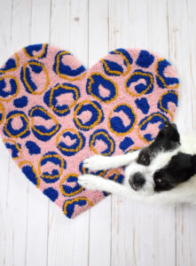 Grab the free embroidery pattern to make this fun and fresh heart-shaped leopard punch needle rug. It's super easy & super unique!