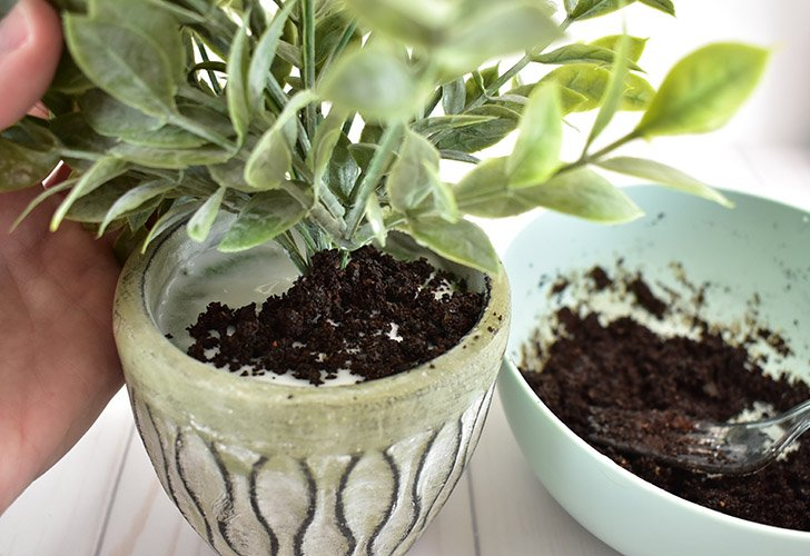 Transfer your fake dirt to the pot spreading it around.