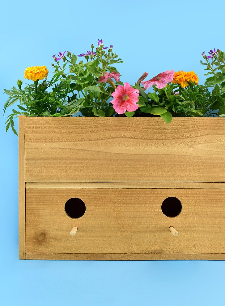 Build a Cedar Picket Birdhouse Planter. Perfect for both gardeners and bird lovers plus it is super easy and inexpensive to make!