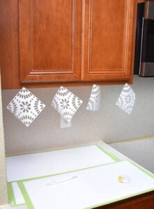 For me, I was able to hang 8 tiles to my upper cabinets like you see here.