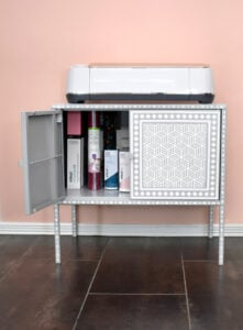 Not only does a maker fit perfectly on top of this cabinet, the interior is the perfect size for all materials Cricut!