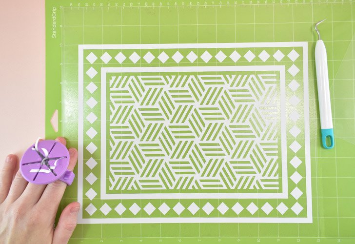 Carefully weed all of the pieces that you do not want to adhere to your cabinet. This includes all of those little lines inside of the geometric cube design of the center.