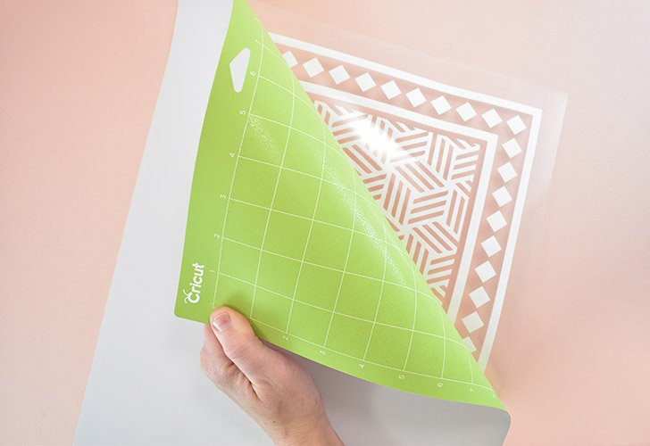 Flip your mat over onto your work surface and pull the mat away from the Iron-On to separate.