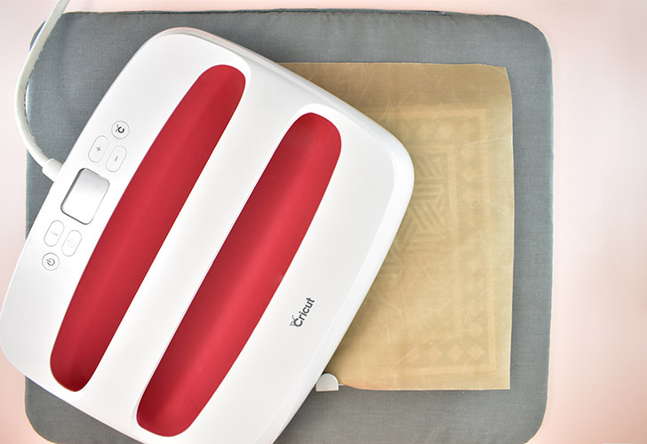 Using an EasyPress or your household iron, apply heat and pressure to the design. (For your Easypress use the setting of 300 degrees and 25 seconds).