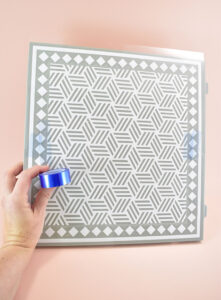 If necessary, use Cricut Heat Resistant Tape to keep the design in place.