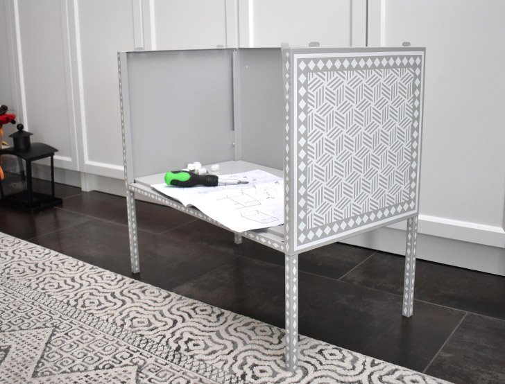 Once all pieces are embellished with your faux bone inlay cabinet design, build using the directions that came with inside of the packaging.