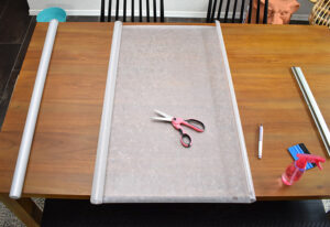 Measure the first section of your window. Unroll the privacy film to the right size and trim with a pair of scissors.