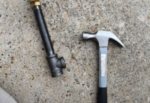 What you want is a pipe shepherd's hook that is sturdy with the weight distributed on each side.