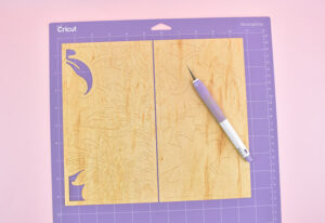 Load the mat into your Cricut Maker and cut the design from this Cricut Design Space File using the veneer settings.