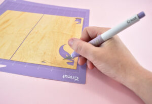 If necessary, use a craft knife, like the Cricut TrueControl to help remove pieces that don't easily come away.
