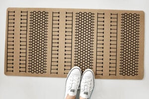 Looking for a modern kitchen mat or entry rug? Check out this awesome and free Design Space file for a DIY Custom Patterned Rug you'll love!