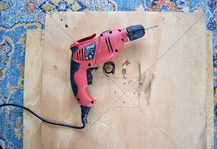 Drill four holes through the board within the area where you traced your 4x4.