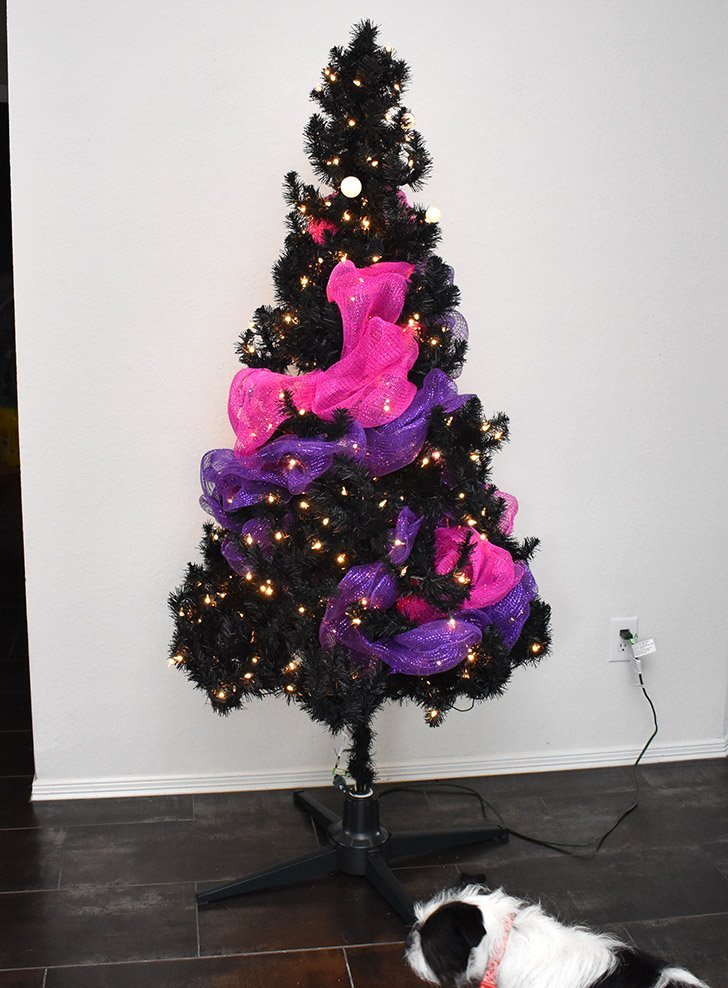 Next add the purple lights and then deco mesh, fitting it around the hot pink shape.